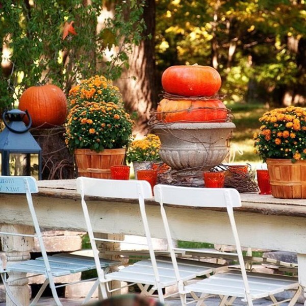 Farmhouse table decorated for Fall