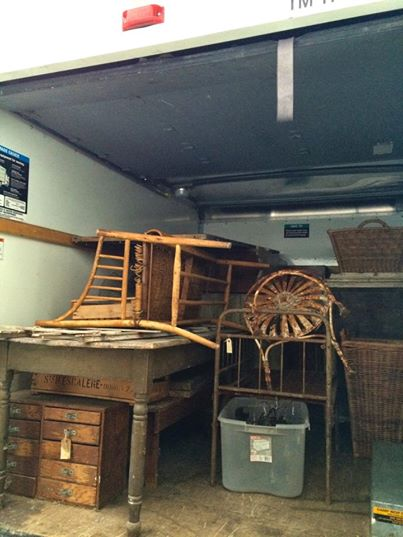 Truck filled with antiques.