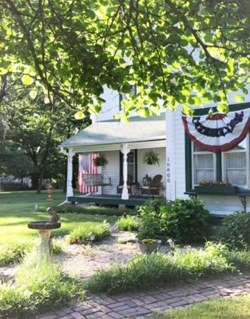 Decorated Farmhouse With Red, White and Blue